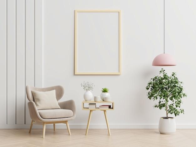 Plakat mit vertikalen rahmen auf leerer weißer wand im wohnzimmerinnenraum mit blauem samtsessel. 3d-rendering Kostenlose Fotos