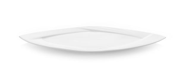Platte auf weißer wand Premium Fotos