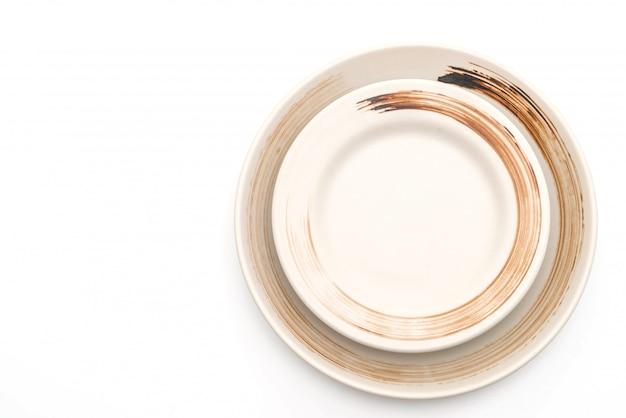 Platte und schüssel getrennt auf weiß Premium Fotos