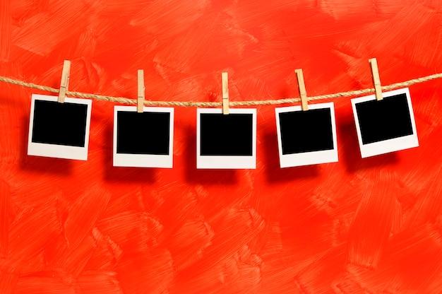 Polaroidart Fotos auf einer Schnur Kostenlose Fotos