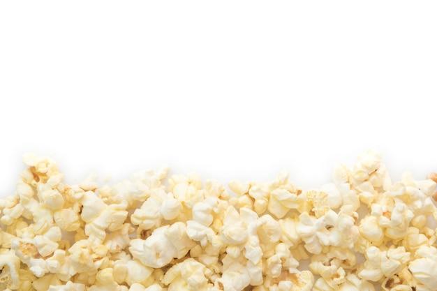 Popcorn auf leerem weißem hintergrund. Premium Fotos