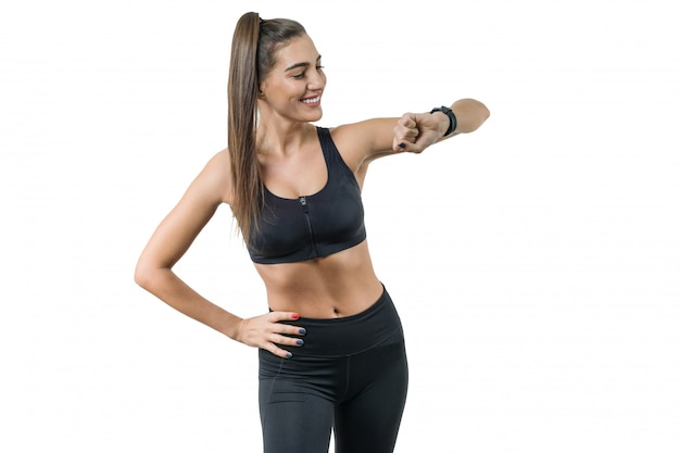 Porträt der lächelnden eignungsfrau in der sportkleidung Premium Fotos