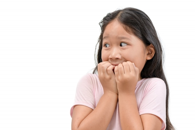 Porträt des entsetzten oder erschrockenen kindermädchens lokalisiert Premium Fotos