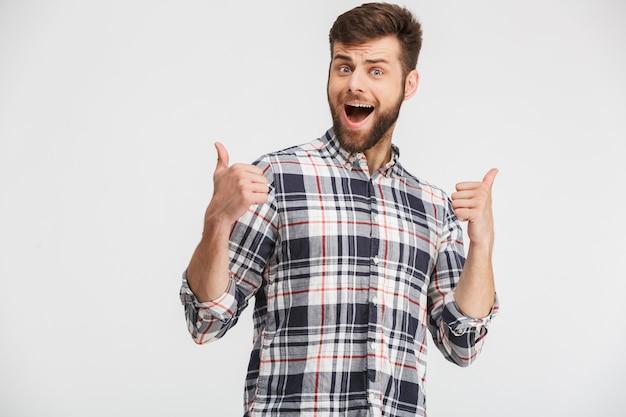 Porträt eines aufgeregten jungen mannes im karierten hemd Premium Fotos