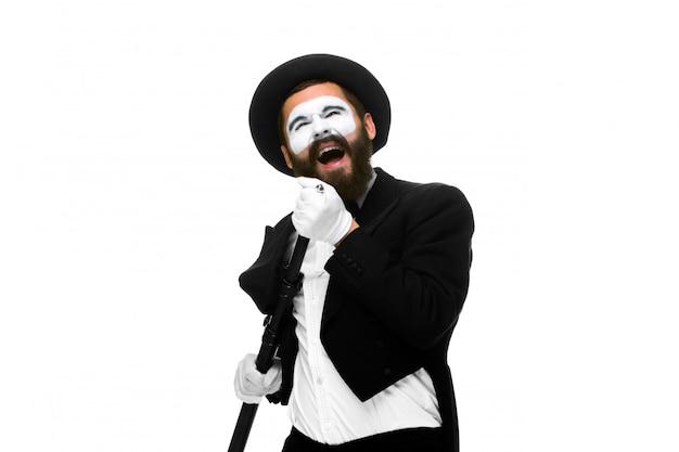 Porträt eines mannes als pantomime mit rohr oder retrostilmikrofon Kostenlose Fotos