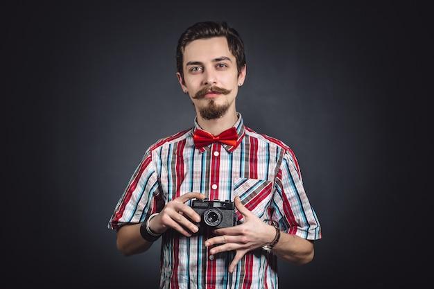 Porträt eines netten fotografen im studio Kostenlose Fotos