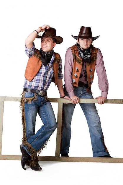 Porträt von zwei cowboys zum äußersten lokalisiert Premium Fotos