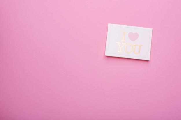 Postkarte ich liebe dich auf rosa Premium Fotos