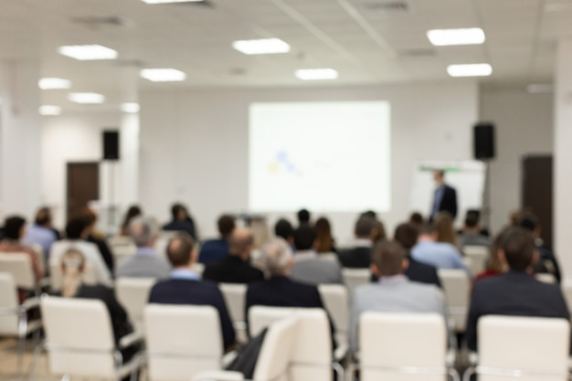 Publikum im konferenzraum. unscharfes bild unscharfes foto. . business und entrepreneurship-konzept. Premium Fotos