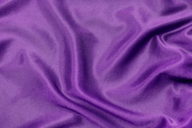 Purpurrote gewebebeschaffenheit für hintergrund und design, schöne seide oder leinen. Premium Fotos