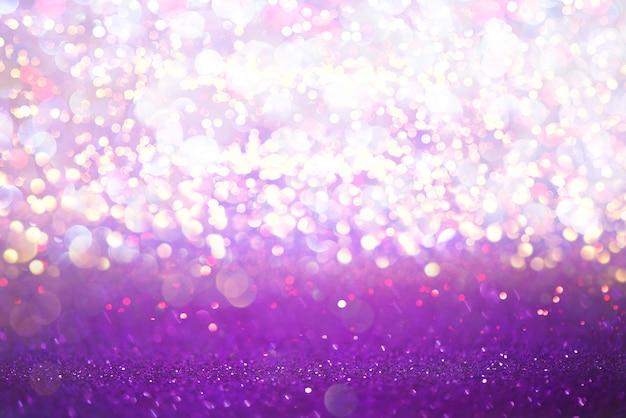 Purpurrotes funkeln beleuchtet beschaffenheit bokeh zusammenfassungshintergrund. defokussiert Premium Fotos