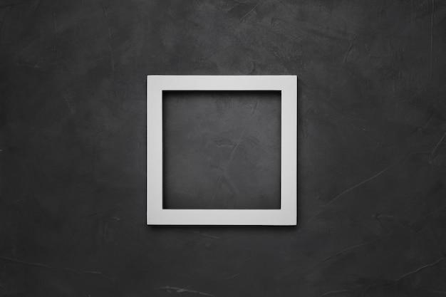 Quadratischer weißer leerer rahmen auf grauem strukturiertem hintergrund mit copyspace Kostenlose Fotos