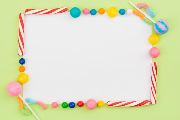 Rahmen aus süßen süßigkeiten erstellt Kostenlose Fotos