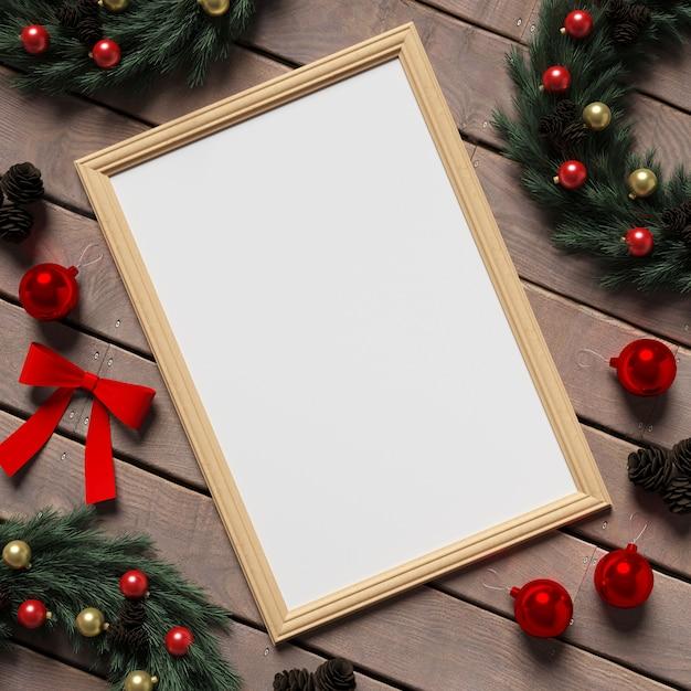 Rahmen-modell auf holzboden mit weihnachtsdekoration Premium Fotos