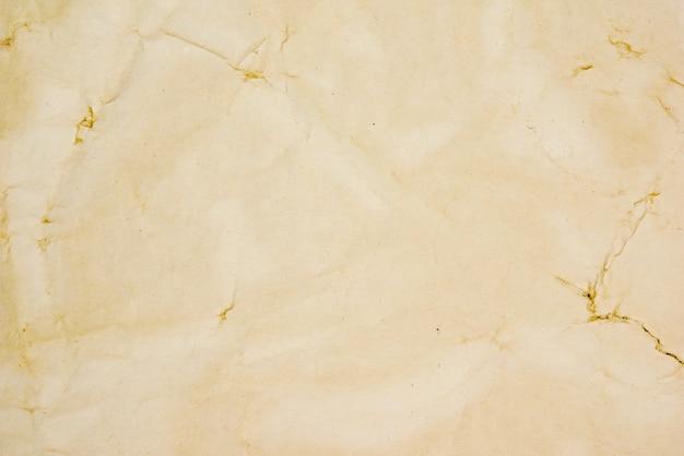 Raue beige papierschmutz-hintergrundbeschaffenheit für design Premium Fotos