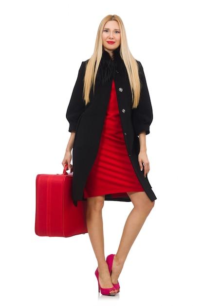 Recht blonde frau, die koffer lokalisiert auf weiß hält Premium Fotos