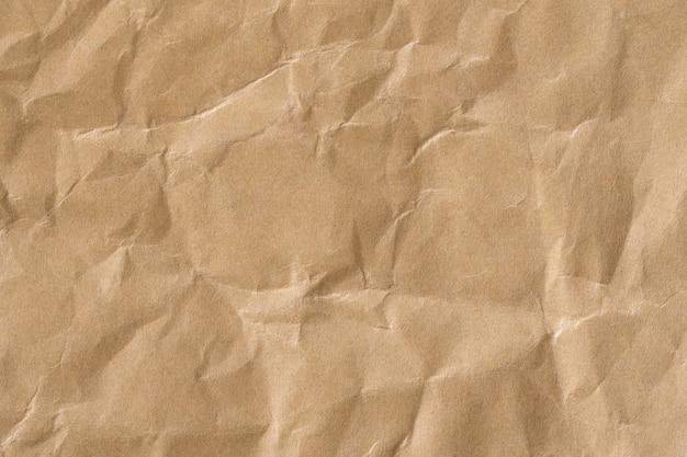 Recyceln sie braune papier zerknitterte textur, alte papieroberfläche für hintergrund Premium Fotos