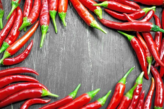 Red hot peppers frame hintergrund Premium Fotos