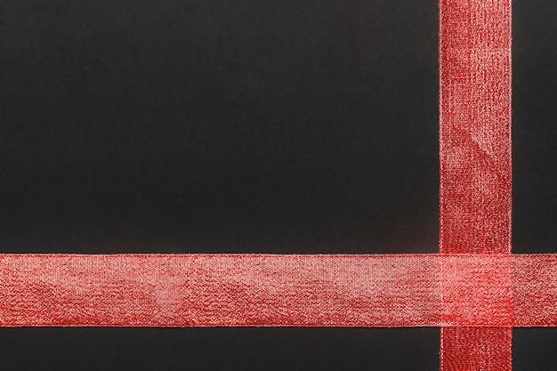 Red ribbon auf dem tisch Kostenlose Fotos