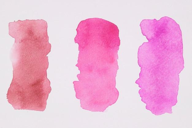 Reihe von rosa und roten farben auf weißbuch Kostenlose Fotos