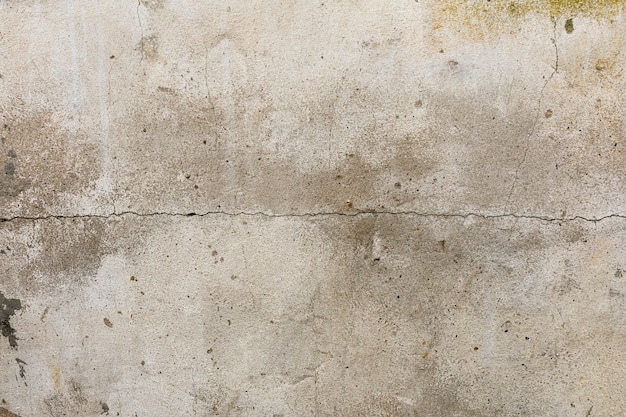 Riss auf rauen betonwand Kostenlose Fotos