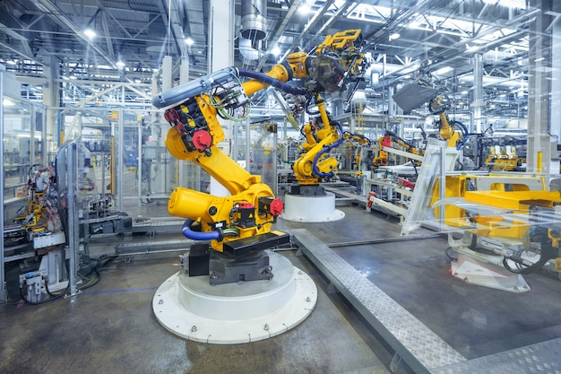 Roboter in einer autofabrik Premium Fotos