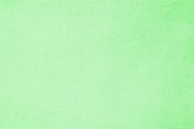 Romantische hellgrüne zementwandbeschaffenheit - pastell Premium Fotos