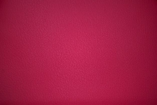Rosa gewebebeschaffenheitshintergrund mit vignettierung Premium Fotos