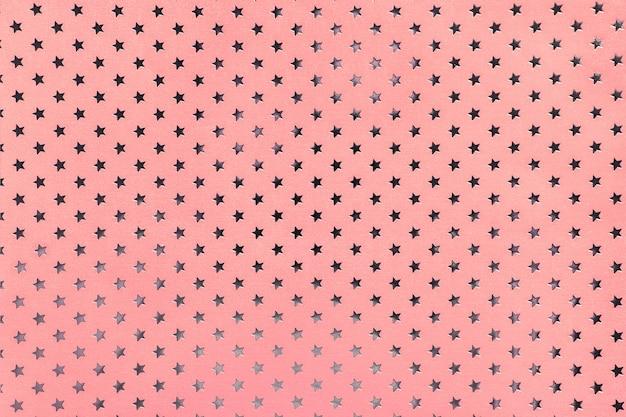 Rosa hintergrund vom metallfolienpapier mit einem silbernen sternchen-vereinbarung Premium Fotos