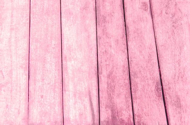 Rosa holzfußboden mit unscharfem musterhintergrund Premium Fotos