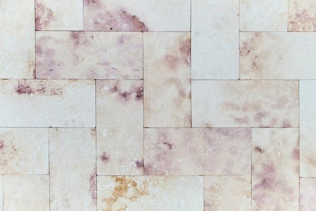 Rosa marmorbacksteinmauerbeschaffenheit Premium Fotos