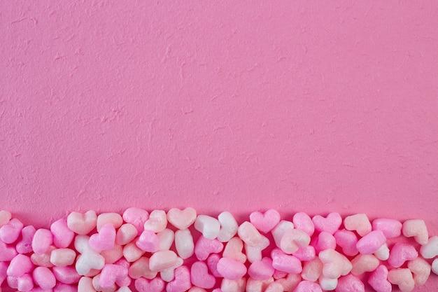 Rosa schaumherzen rosa papierhintergrund Premium Fotos
