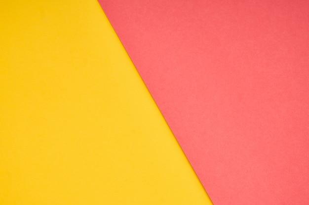 Rosa und gelbe pastellpapierfarbe für hintergrund Premium Fotos