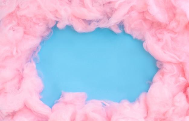 Rosa watte hintergrund, abstrakte flauschige weiche farbe süße zuckerwatte textur mit kopie raum Premium Fotos