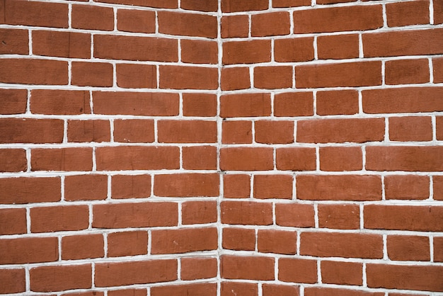 Rote backsteinmauer in der perspektive. Premium Fotos