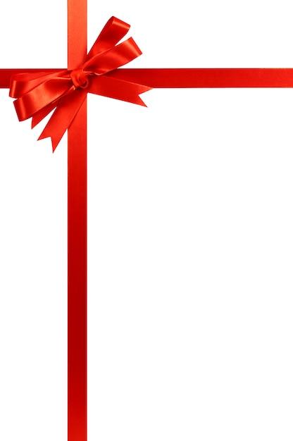 Rote bogenweihnachtsgeschenk-bandvertikale Premium Fotos
