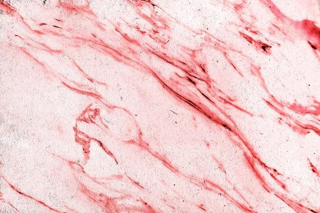 Rote marmorstruktur mit kratzern und rissen mit copyspace Premium Fotos