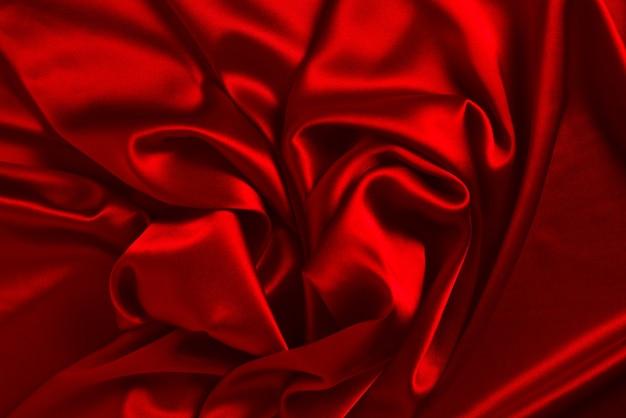 Rote seide oder satin luxus stoff textur kann als abstrakter hintergrund verwendet werden. draufsicht. Premium Fotos