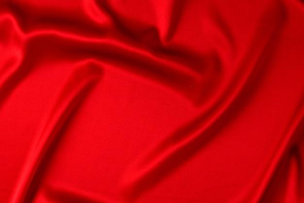 Rote seide oder satin luxus stoff textur kann als abstrakter hintergrund verwendet werden. draufsicht Premium Fotos
