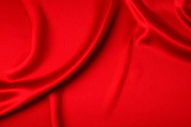 Rote seide oder satin luxus stoff textur kann als abstrakter hintergrund verwendet werden Premium Fotos