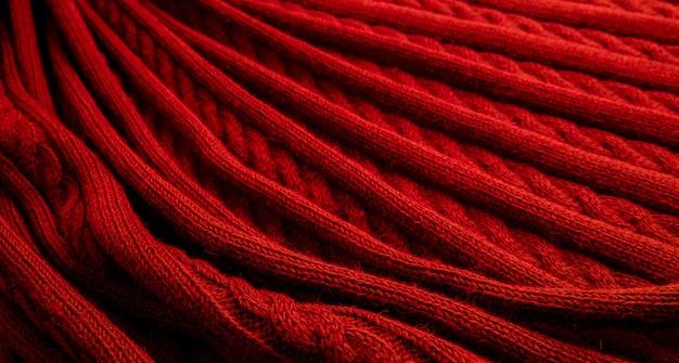 Rote textur aus feinem wollstoff Premium Fotos