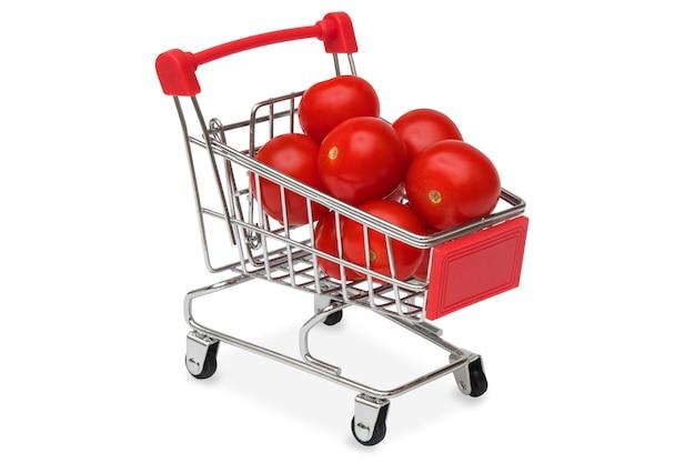 Rote tomaten in einem supermarktwagen Premium Fotos