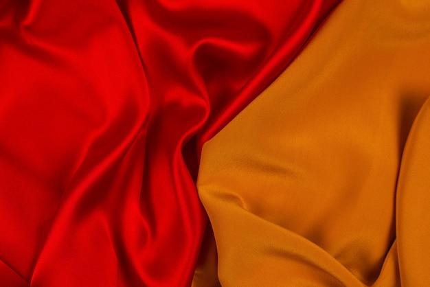 Rote und orange seide oder satin luxus stoff textur kann als abstrakter hintergrund verwendet werden. Premium Fotos