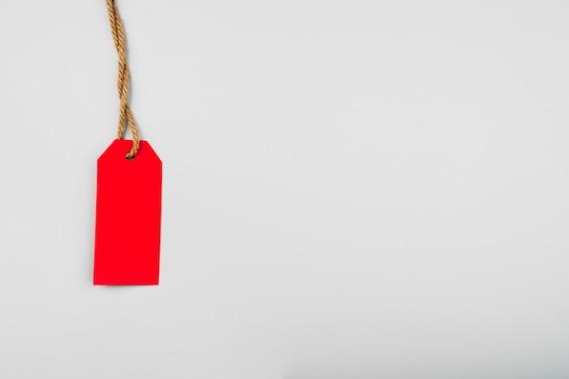 Roter aufkleber auf normalem hintergrund mit kopienraum Kostenlose Fotos