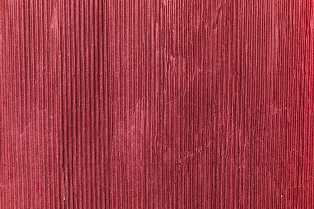 Roter papierbeschaffenheitshintergrund Kostenlose Fotos