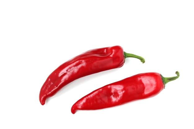 Roter paprika befindet sich auf einer weißen oberfläche, draufsicht, kopierraum Premium Fotos