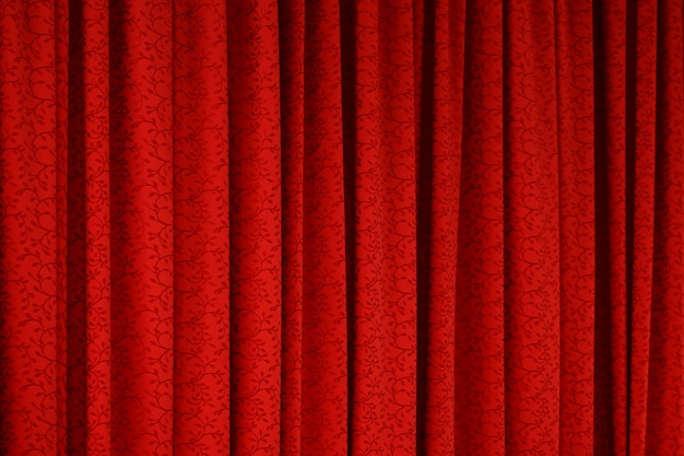 Roter vorhangbeschaffenheitshintergrund Premium Fotos