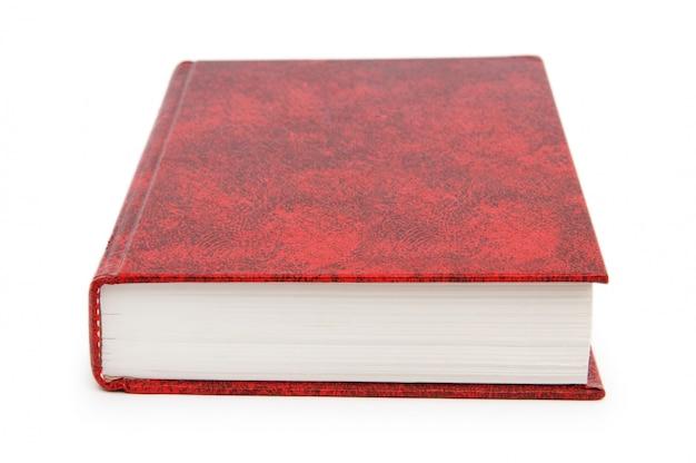 Rotes abdeckungsbuch getrennt auf weiß Premium Fotos