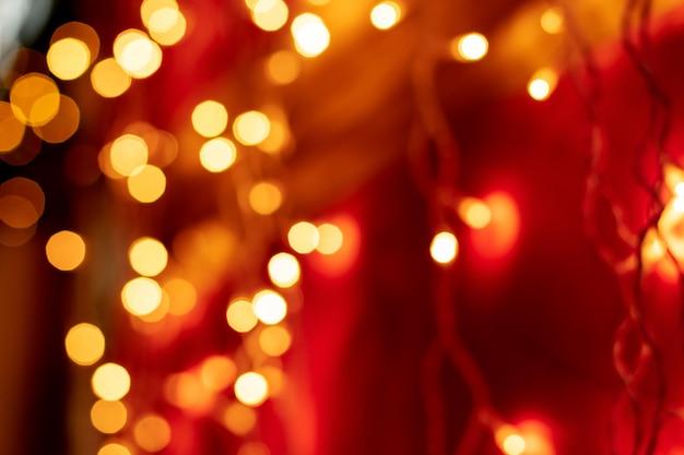 Rotes bokeh unscharfer lichthintergrund Premium Fotos