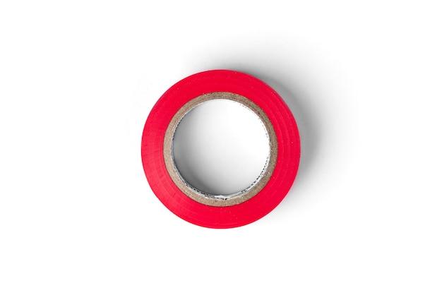 Rotes elektrisches band lokalisiert auf weißem hintergrund. Premium Fotos